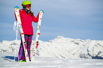 Girl standing with arms spreading wide open on the fresh powder
