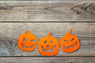 Halloween holiday background with pumpkins Jack-o'-Lantern cut