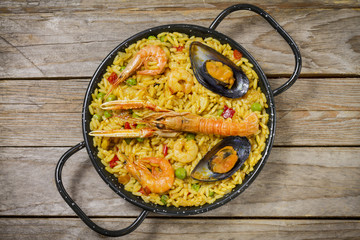 Spanish paella on a wooden table