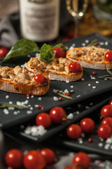 Bruschetta with smoked meat and cherry tomatoes