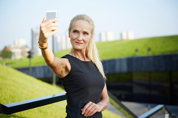 Confident woman taking selfie