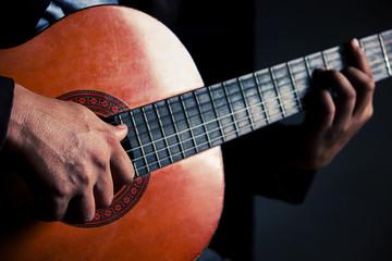 Guitar instrument. Musician or guitarist. Music, musical sound.