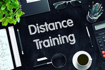 Distance Training - Text on Black Chalkboard. 3D Rendering.