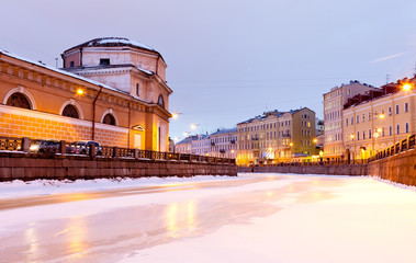 Night View of the frozen River Moika in St Petersburg. To the left is Church of the Holy Face