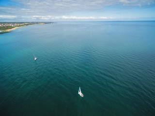 Aerial image of two sailing sailboats