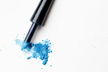Scattered blue shadows with applicator on pure background