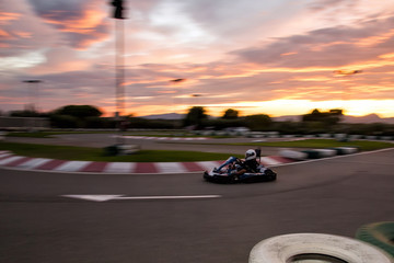 Go-Kart track. Sunset. Motion blur