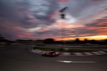 Go-Kart track. Sunset. Motion blur