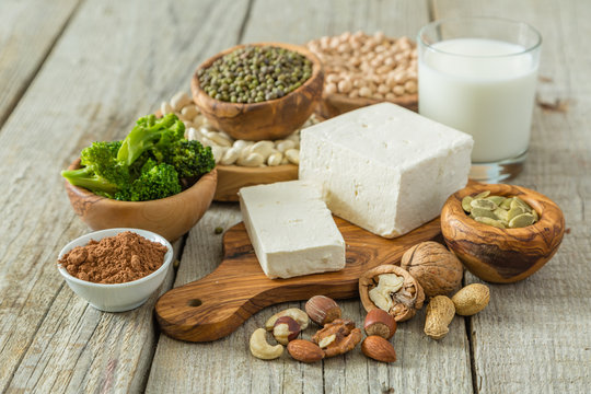 Selection vegan protein sources on wood background