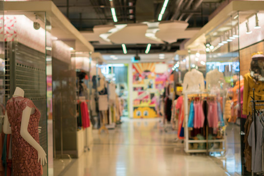 Blurred image of clothing boutique store interior. Defocused bac