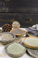 Ancient minerals - black, green, blue clay powder and mud mask