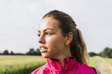 Sportive young woman in rural landscape