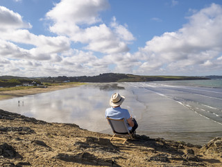 Senior man sitting on beach