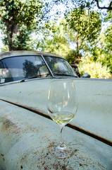 wine glass sitting on old, rusted car