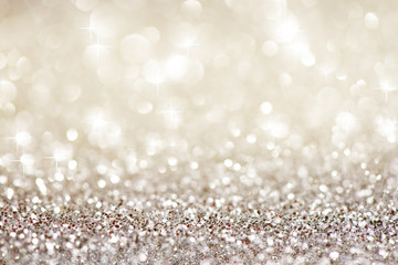 Silver white glittering Christmas lights. Festive abstract glitter bokeh background