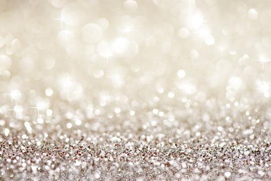 Silver white glittering Christmas lights. Festive abstract glitter bokeh background
