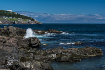 waves crashing on rocky shore of Newfoundland
