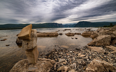 Inukshuk on shoreline of Western Brook Pond