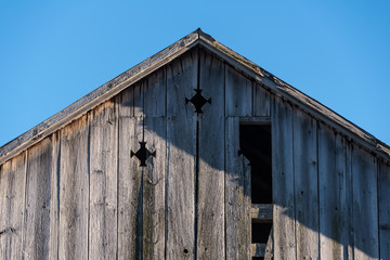 Peak of old barn in strong sunlight