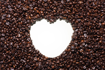 Coffee beans. Roasted coffee beans with shape heart on backgroun