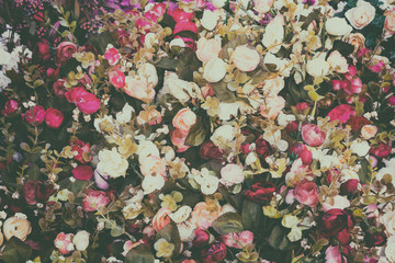 Colorful background of various artificial flowers, vintage style image