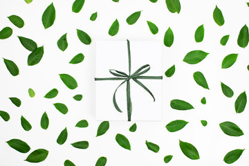 gift boxes with green leaf on white background.
