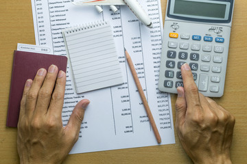 Man planning monthly budget, Finance about Travel concept