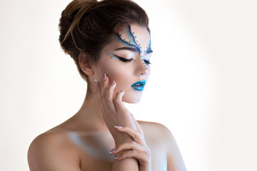 Snow queen fashion portrait. Holiday makeup.