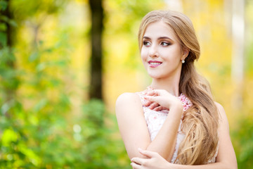 The beautiful gentle girl in the autumn forest in the afternoon. Girl autumn