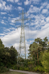 View side of high voltage pole in blue sky