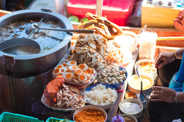 Noodle shop on boat at Damnoen Saduak Floating Market in Thailand.