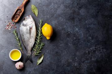 Foto auf Acrylglas Fisch Raw fish cooking ingredients