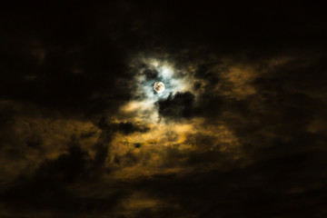 Full moon and clouds  on stormy overcast night