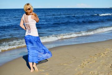 Foto op Aluminium Cyprus Young woman on beach
