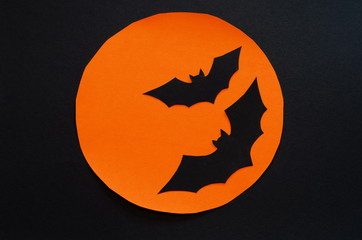 Halloween symbols cut out of craft paper, paper background and black silhouettes, trick or treat