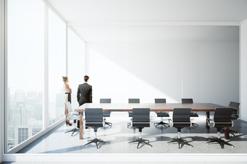 Businessman and woman in conference room