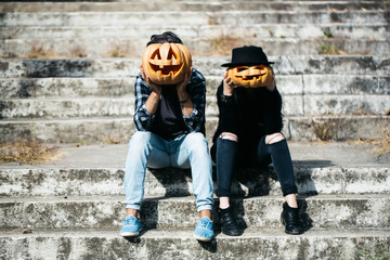 halloween couple with pumpkin