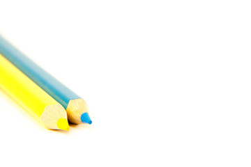 two pencils yellow and blue