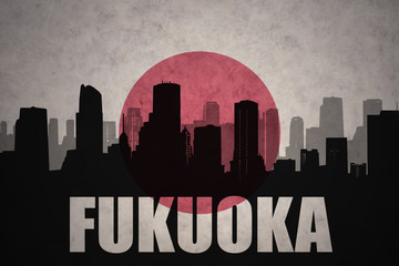 abstract silhouette of the city with text Fukuoka at the vintage japanese flag background