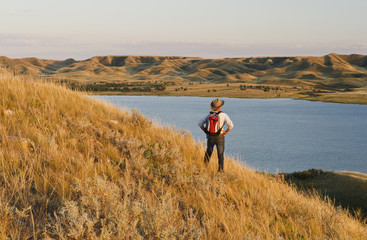 hiker, Saskatchewan Landing Provincial Park with Lake Diefenbaker in the background,  Saskatchewan, Canada