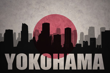 abstract silhouette of the city with text Yokohama at the vintage japanese flag background