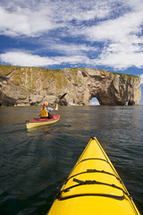 Sea-kayaking near Perce Rock, Gaspe, Quebec, Canada.
