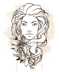 Beauty woman with flowers in her long hair