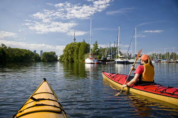 Sea-kayaking around Center Island in the Toronto Harbour, Lake Ontario, Toronto, Ontario, Canada.
