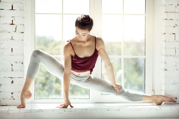 Skillful modern dancer sitting in a position