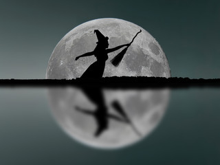 Halloween witch silhouette flying with broomstick. Full Moon. Re