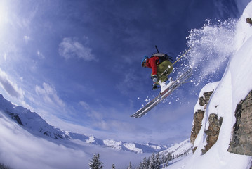 Airborne skier in the backcountry of Kicking Horse Resort, Golden, British Columbia, Canada