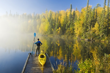 a man and kayak on dock, Dickens Lake, Northern Saskatchewan, Canada