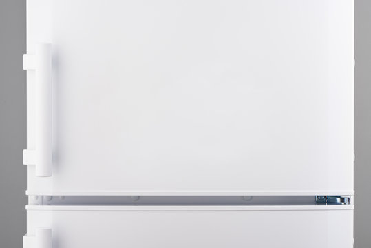 White refrigerator on gray