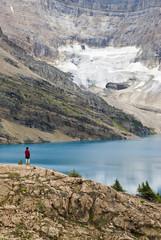 A woman overlooks Lake McArthur in the Lake Ohara Region of Yoho National Park, British Columbia, Canada.